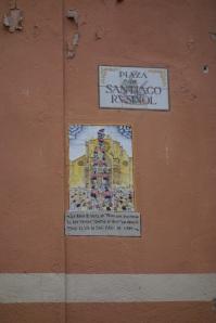 Emblematic tiles set into walls.